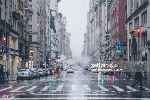 traffic on city street - pedestrian crossing stock photos and pictures