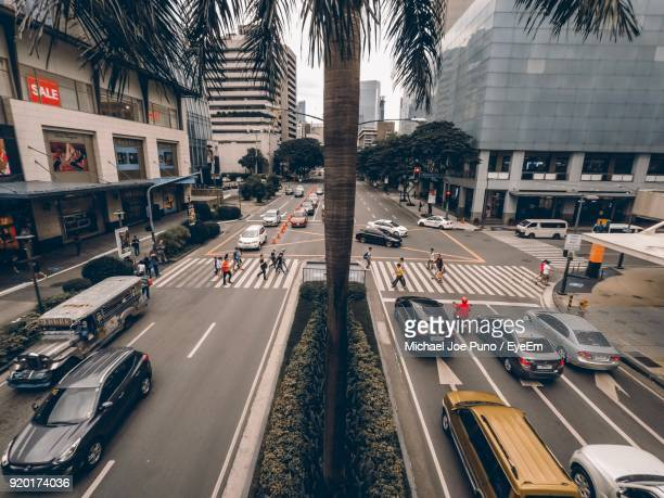 traffic on city street - makati stock photos and pictures