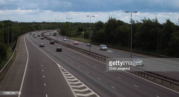 traffic on curve in busy expressway - driving stock pictures, royalty-free photos & images