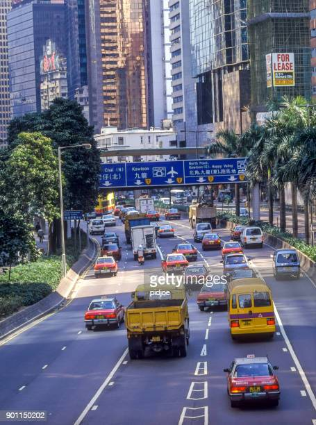 traffic on Gloucester Road in Wanchai Hong Kong. view from pedestrian bridge on the traffic on Gloucester Road, Wanchai Hong Kong, skyscrapers in the background