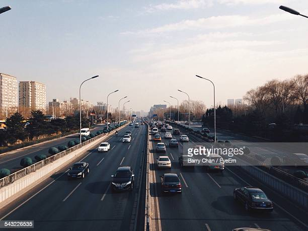 Traffic On Highway In City Against Sky