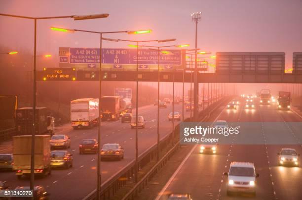 Traffic on Highway in Heavy Fog