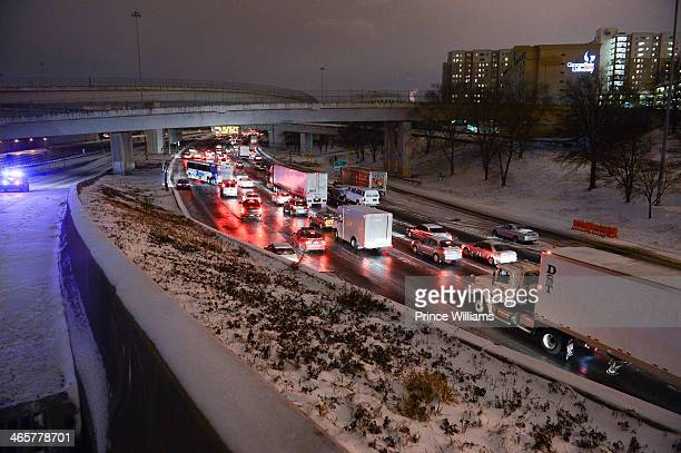 Traffic on Interstate 75/85 deals with snow and ice conditions on January 28 2014 in Atlanta Georgia A rare winter storm has brought ice and snow...
