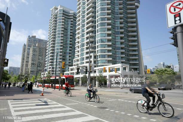 traffic on queens quay west, toronto, ontario - road junction stock pictures, royalty-free photos & images