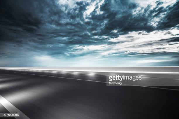 traffic on road at night - atmospheric mood stock pictures, royalty-free photos & images