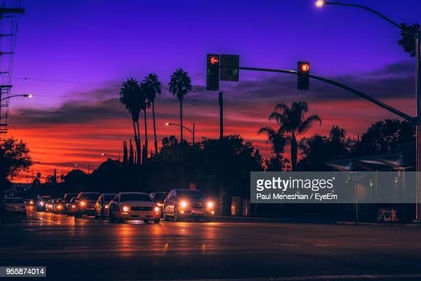 traffic on road at night - san fernando california stock photos and pictures