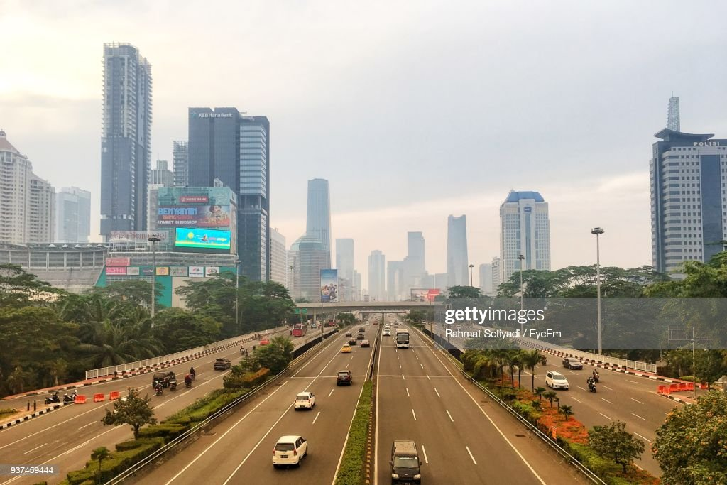 Traffic On Road In City Against Sky : Stock Photo