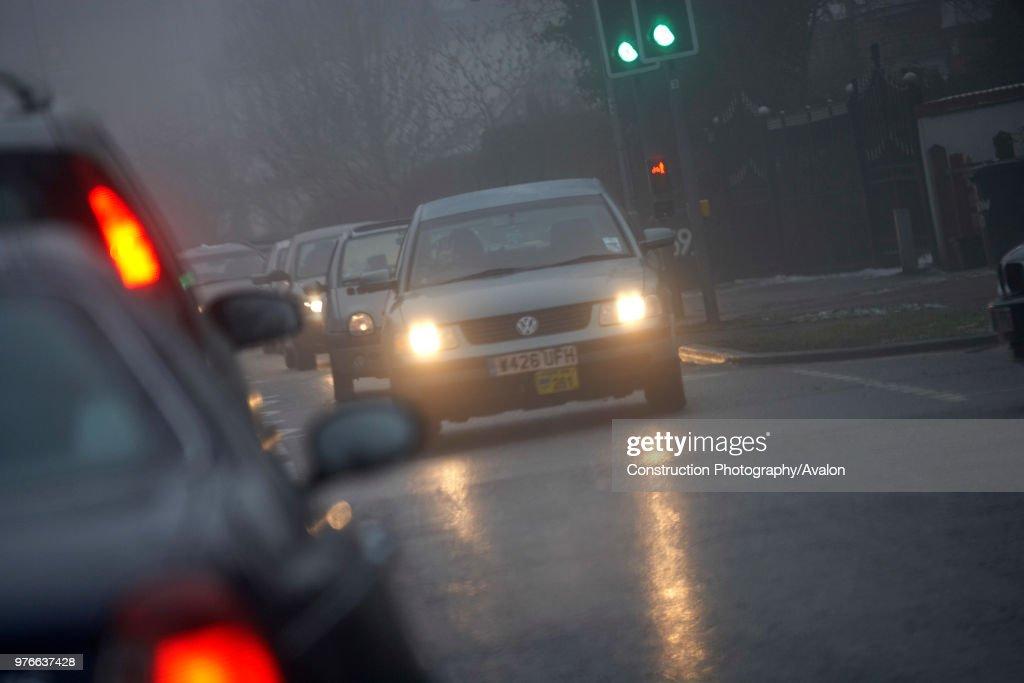 Traffic on road with bad visibility, rain and fog, United Kingdom : ニュース写真