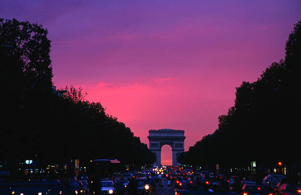Traffic on the Champs-Elysees and the Arc de Triomphe after sunset.