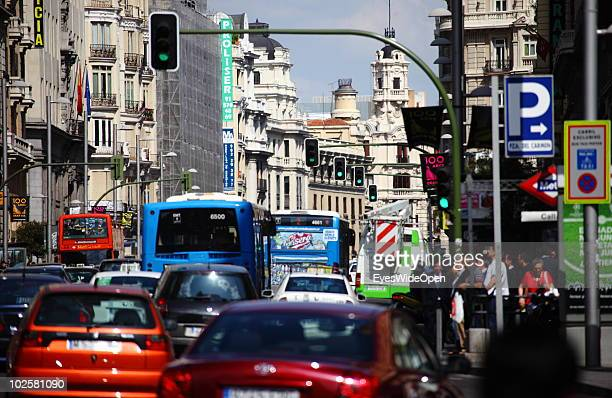 Traffic on the famous boulevard Gran Via in Madrid on May 24 2010 in Madrid Spain Madrid is a big European city with more than 3 million inhabitants