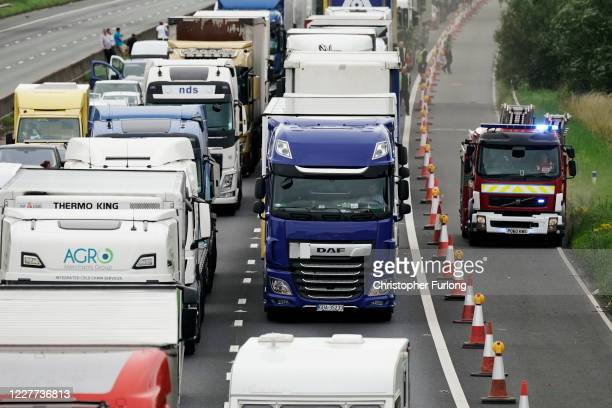 Traffic on the M6 comes to a halt as the motorway is shut in both directions due to a lorry fire on July 22, 2020 in Knutsford, England.
