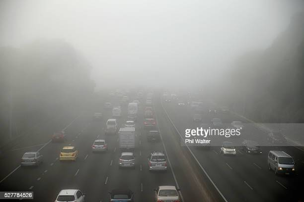 Traffic on the motorways is backed up under a blanket of fog over Auckland City on May 4 2016 in Auckland New Zealand The morning fog disrupted...