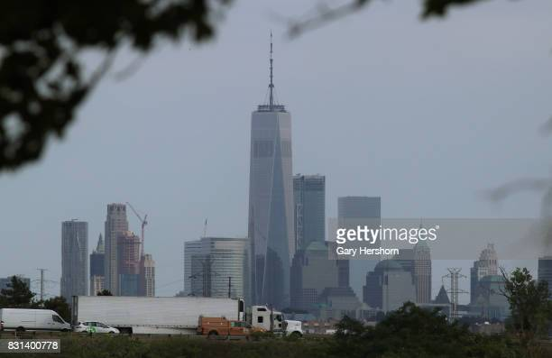 Traffic on the New Jersey Turnpike drives past the skyline of lower Manhattan and One World Trade Center in New York City on August 11 2017 as seen...