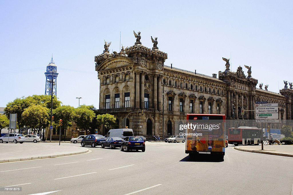 Traffic on the road in front of a building, Barcelona, Spain : Foto de stock