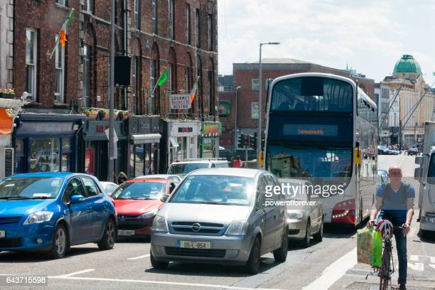 traffic on the streets of cork, ireland - cork city stock pictures, royalty-free photos & images
