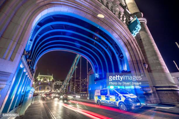 traffic on tower bridge (london) - police car stock photos and pictures