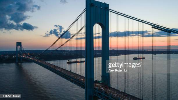 traffic on verrazano-narrows bridge at sunset. aerial drone photo - staten island stock pictures, royalty-free photos & images
