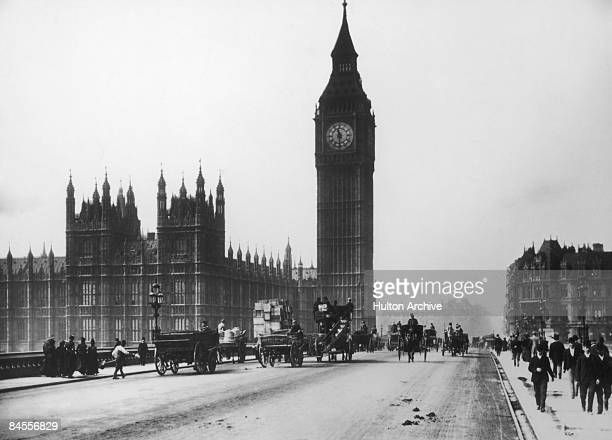 Traffic on Westminster Bridge with the Houses of Parliament and Big Ben in the background London circa 1900