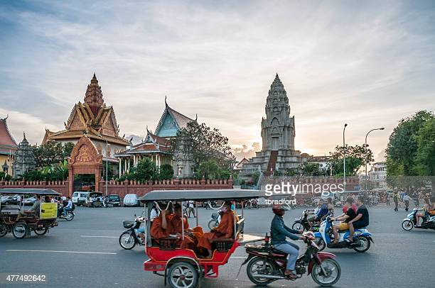 Traffic Outside Wat Ounalom At Sunset In Phnom Penh, Cambodia