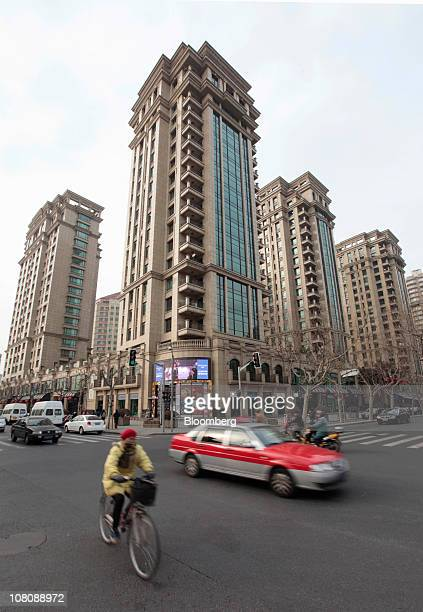 Traffic pases in front of a housing complex in Shanghai China on Monday Jan 17 2011 Shanghai China's financial center will this year prepare for a...