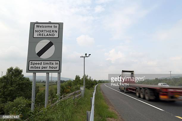 Traffic passes a border sign at Newry as you enter Northern Ireland from the south on June 7 2016 The border that divides the island of Ireland is...