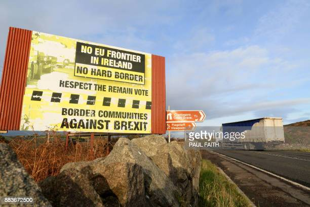 Traffic passes a Brexit Border poster on the Dublin road Co Armagh border between Newry in Northern Ireland and Dundalk in the Irish Republic on...