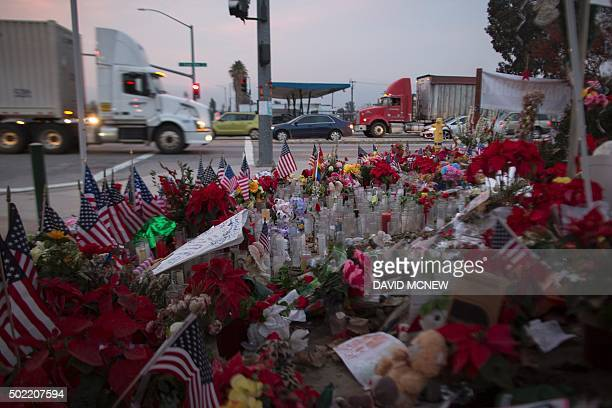 Traffic passes a makeshift memorial near the Inland Regional Center in San Bernardino California December 21 2015 Enrique Marquez who is alleged to...