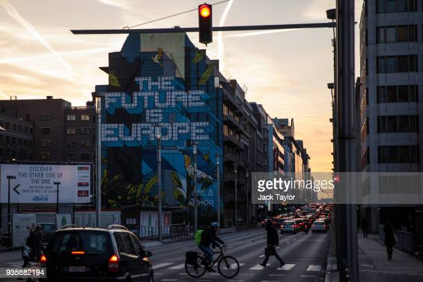 Traffic passes a piece of street art on the side of a building in central Brussels which reads 'The Future is Europe' on March 21 2018 in Brussels...