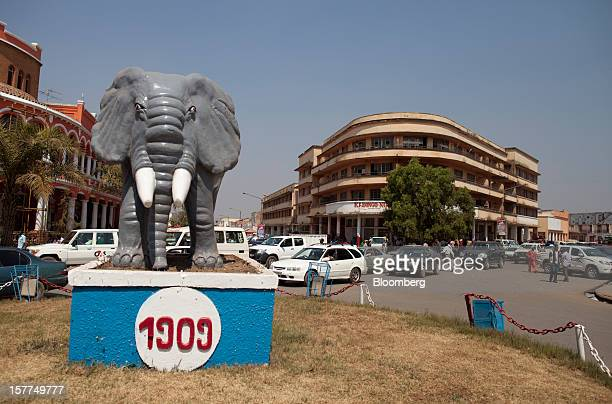 Traffic passes a statue of an elephant displayed on a traffic island in central Lubumbashi Democratic Republic of Congo on Tuesday July 31 2012...