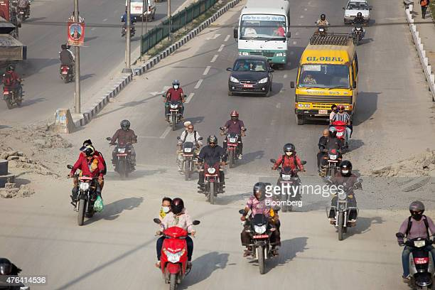 Traffic passes along an earthquakedamaged road in Kathmandu Nepal on Wednesday June 3 2015 Nepal's gross domestic product will probably grow 38% in...