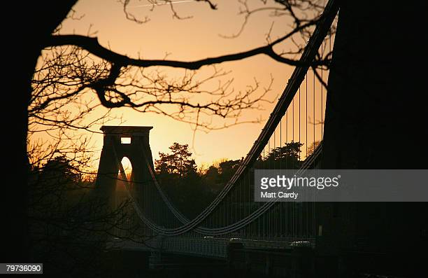 Traffic passes along Clifton Suspension Bridge as the sun sets on February 12 in Bristol United Kingdom Spanning the Avon Gorge the Grade I listed...