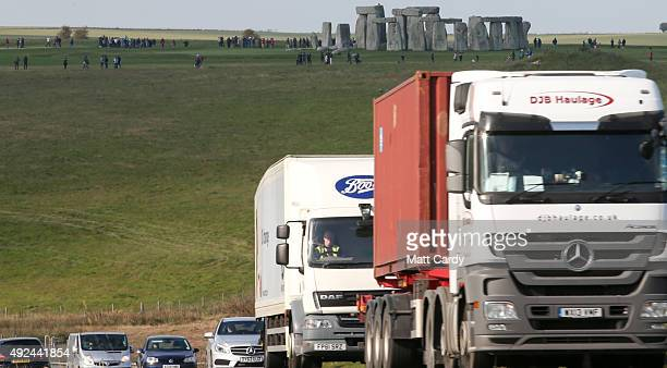 Traffic passes along the busy A303 that runs besides the ancient neolithic monument of Stonehenge on October 13 2015 in Wiltshire England The UK...