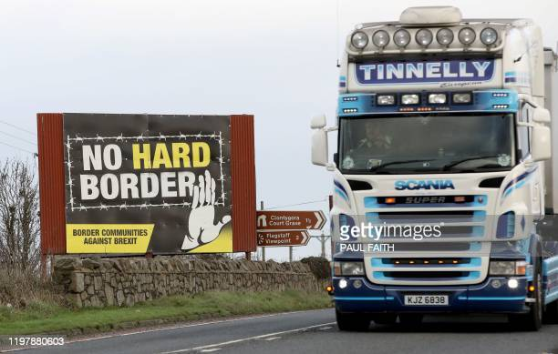 Traffic passes an No Hard Border antiBrexit proIrish unity billboard poster as it crosses the border road between Newry in Northern Ireland on...