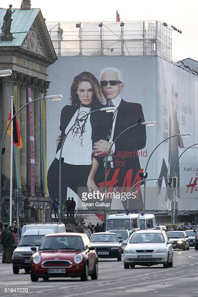 Traffic passes by a giant 1,500 square meter advertisement for Swedish fashion retailer H&M that shows German-born fashion designer Karl Lagerfeld...
