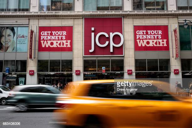 Traffic passes by a JC Penney department store at the Manhattan Mall, May 15, 2017 in the Herald Square neighborhood in New York City. Shares of the...