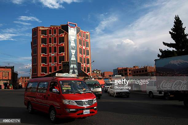 """Traffic passes by a recently constructed building known locally as a """"cholet,"""" for its incorporation of indigenous architecture, in El Alto, Bolivia,..."""