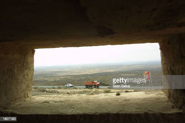 Traffic passes by a semiconcealed bunker February 21 2003 in Djibouti Town Djibouti Located in the Horn of Africa Djibouti has taken on strategic...