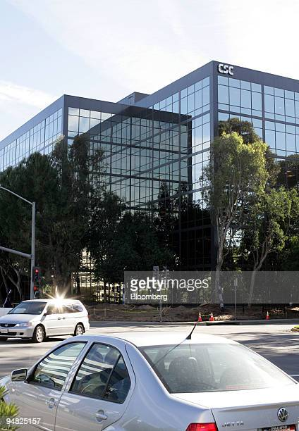Traffic passes by Computer Sciences Corp's El Segundo, California, offices where installation of a security fence is taking place on Thursday...