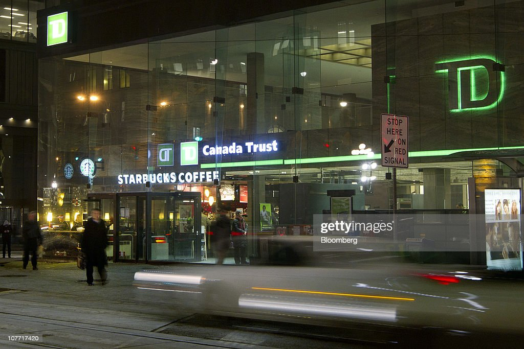 Traffic passes by one of Toronto-Dominion Bank's (TD) Canada Trust branches in Toronto, Ontario, Canada, on Monday, Dec. 20, 2010. Toronto-Dominion Bank agreed to buy Chrysler Financial Corp. from Cerberus Capital Management LP for $6.3 billion in cash, adding an auto-finance company in its second-largest acquisition. Photographer: Norm Betts/Bloomberg via Getty Images