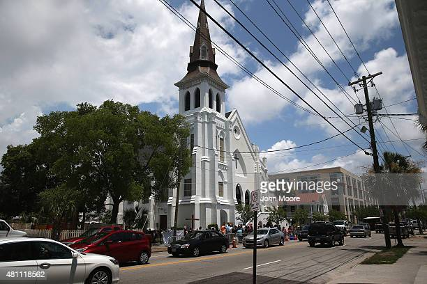 Traffic passes by the Emanuel AME Church on the onemonth anniversary of the mass shooting on July 17 2015 in Charleston South Carolina Visitors from...