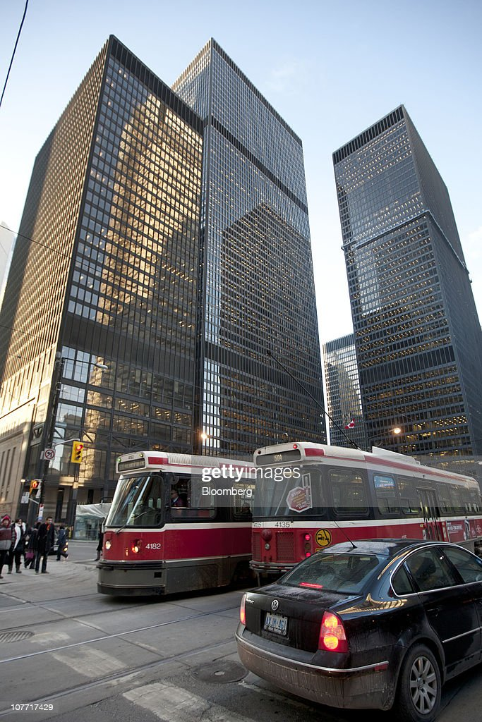 Traffic passes by the headquarters building of Toronto-Dominion Bank (TD) in Toronto, Ontario, Canada, on Tuesday, Dec. 21, 2010. Toronto-Dominion Bank agreed to buy Chrysler Financial Corp. from Cerberus Capital Management LP for $6.3 billion in cash, adding an auto-finance company in its second-largest acquisition. Photographer: Norm Betts/Bloomberg via Getty Images