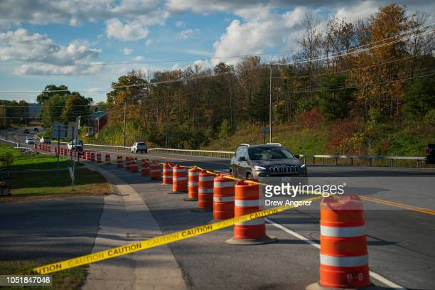 Traffic passes by the site of a fatal limousine crash that killed 20 people near the intersection of Route 30 South and Route 30A October 10 2018 in...