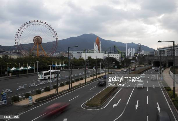 Traffic passes by the Space World theme park operated by Space World Inc left in Kitakyushu Japan on Thursday March 2 2017 Kitakyushu with nearly a...
