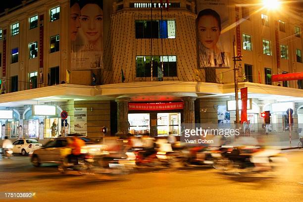 Traffic passes in front of Hanoi's main department store which has become a gathering place for the city's increasingly affluent and growing middle...