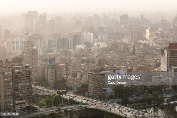 Traffic passes over the 6th of October bridge into Dokki Giza on September 24 2017 in Cairo Egypt Overview photos of Cairo's buildings cityscape and...