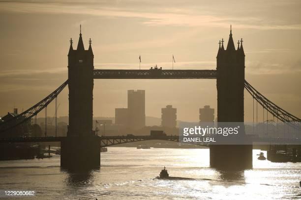 Traffic passes over the River Thames on Tower Bridge in London during the morning rush hour on October 15, 2020. - Prime Minister Boris Johnson on...
