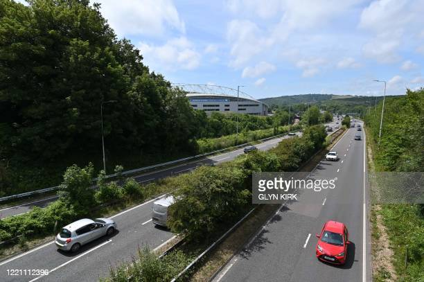 Traffic passes the American Express Community Stadium in Brighton southern England on June 20 2020 ahead of the English Premier League football match...