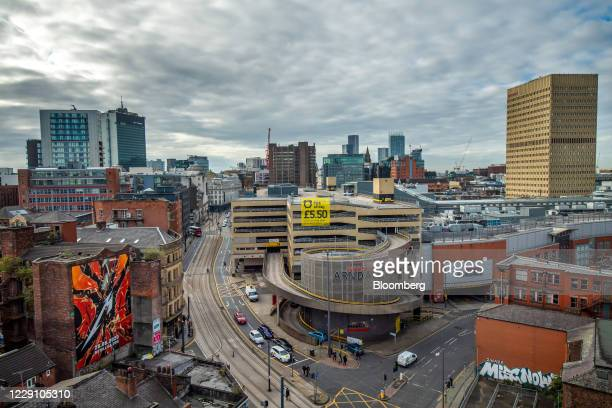 Traffic passes the Arndale Centre shopping mall in Manchester, U.K., on Friday, Oct. 16, 2020. London will face tighter restrictions from Saturday,...