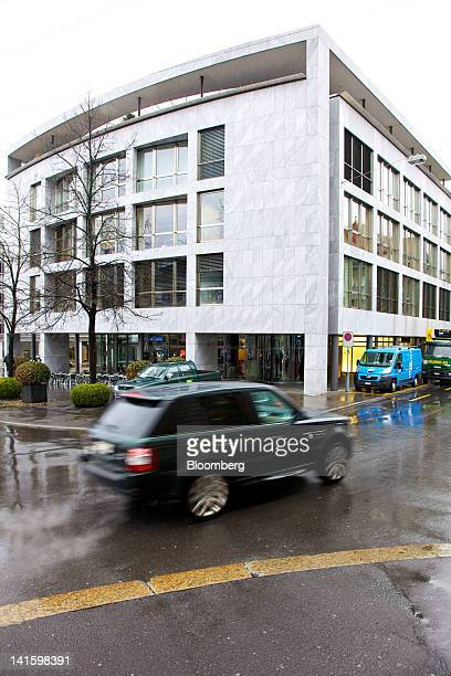 Traffic passes the building that houses the headquarters of Xstrata Plc in Zug, Switzerland, on Monday, March 19, 2012. Glencore International Plc...