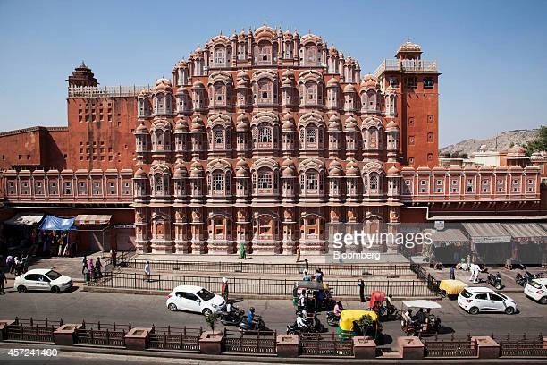 Traffic passes the Hawa Mahal palace in Jaipur Rajasthan India on Monday Oct 13 2014 Indias retail inflation slowed more than economists had...